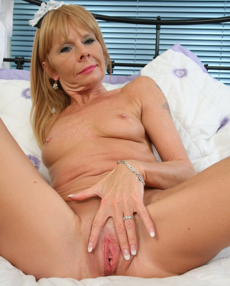 Nude Fifty Year Old Spreading Her Legs