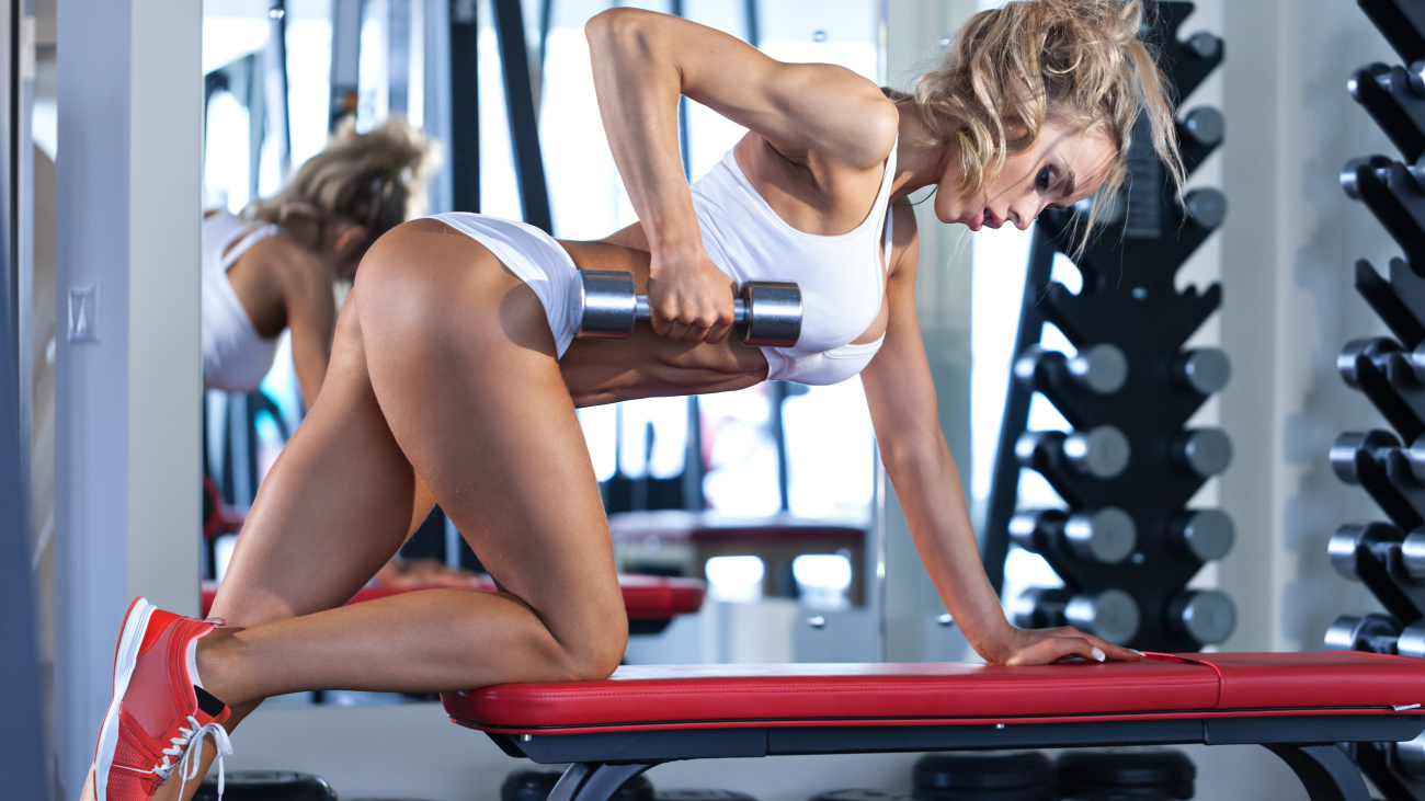 Pretty woman workout with dumbbell